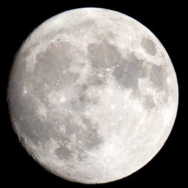 The Moon close-up on a black night sky shot through a telescope