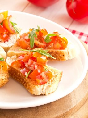 Bruschetta from tomatoes and rucola