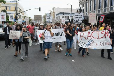 Protesters carried placards in support Trayvon and other victims of violence.