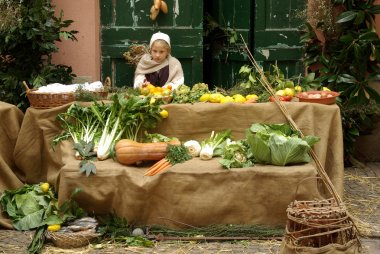 Medieval market. Participant of medieval costume party