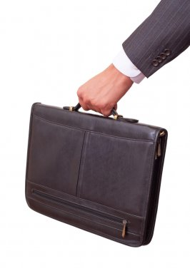 Casual Man holding in hand a briefcase . Isolated on white background. With clipping path included