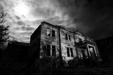 Abandoned spooky hotel at the night - horror movie scene