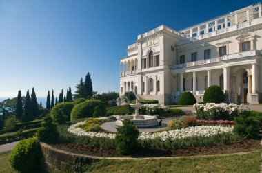 Livadia Palace was a summer retreat of the last Russian tsar, Nicholas II, and his family in Livadiya, Crimea. Livadia Palace is situated against the blue sky background. Ukraine