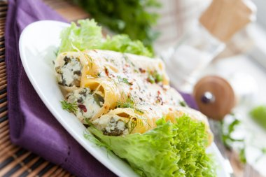 cannelloni with goat cheese and chopped greens