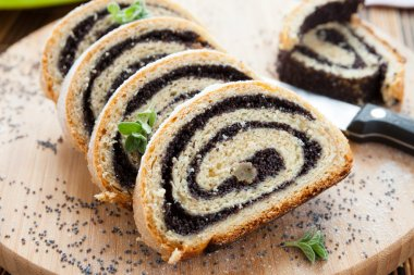 poppy seed Roll on a wooden surface
