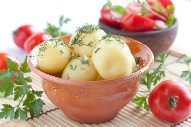 Boiled potatoes and tomato salad