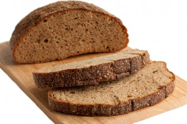 A delicious brown bread on the cutting board