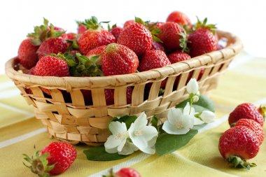 Sweet strawberries in a wicker basket