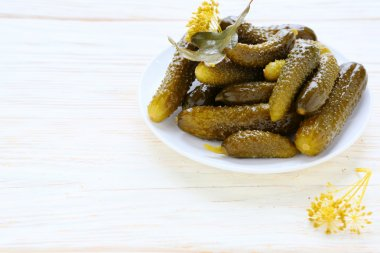 pickled cucumbers on a white plate