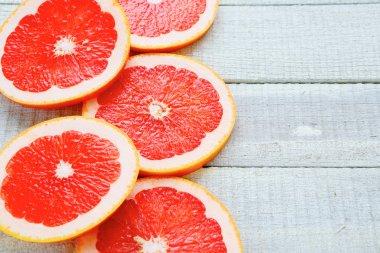 ripe grapefruit on white boards