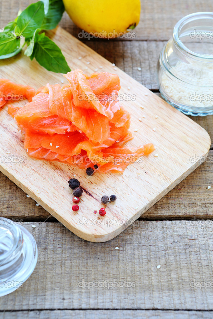 salmon pieces on the board and sesame — Stock Photo © olhaafanasieva