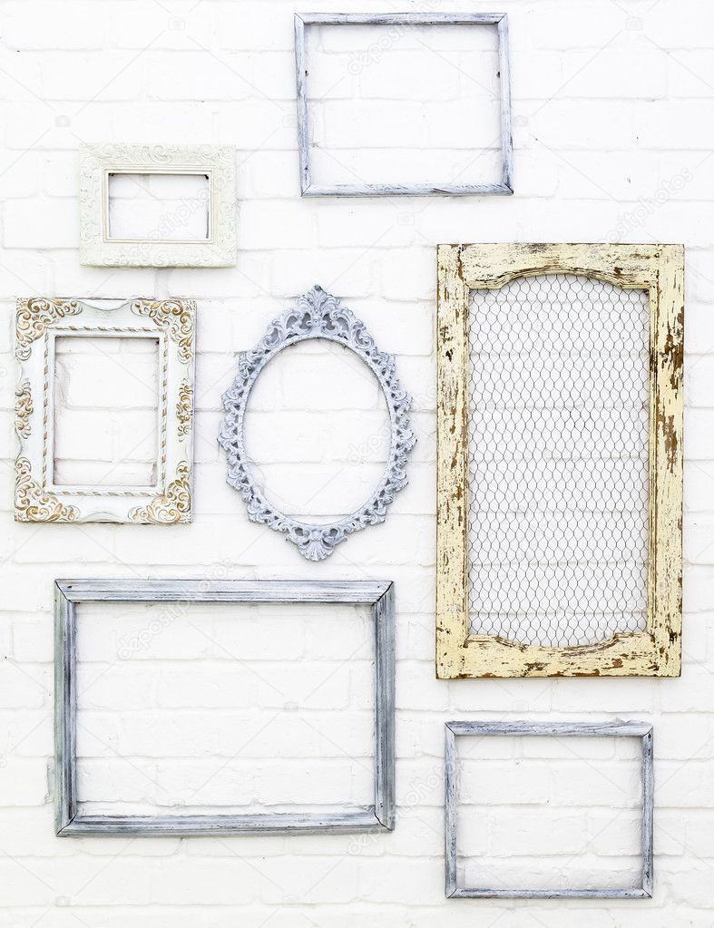 Vintage picture frames on white brick wall background — Stock Photo ...