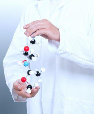 Chemist with molecule