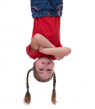 funny little girl hanging upside down