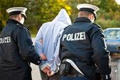 Photo Police officers arrest man