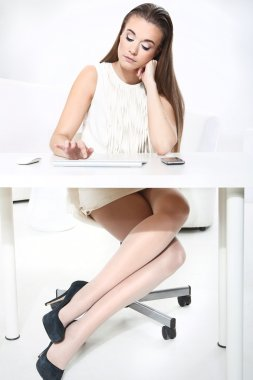 Girl working at a computer in the office
