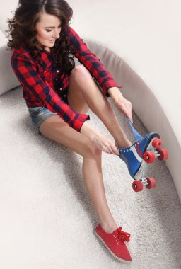 Young woman dress roller-skates