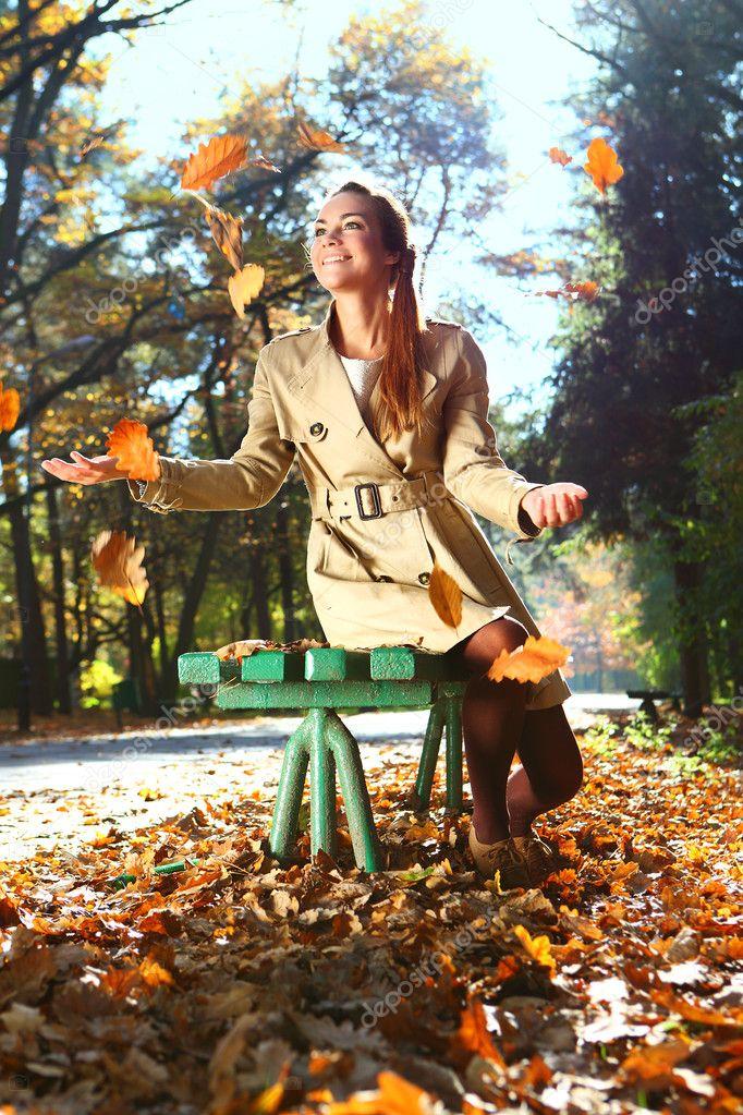 Woman in autumn scenery
