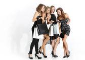 Fotografie Gruppe von Mädchen betrachten einkaufen