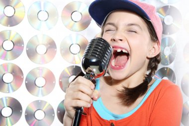 Singing girl in the orange cap