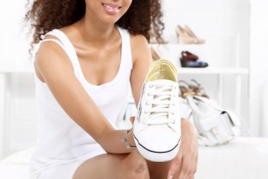 Sport shoes, sneakers girl buys