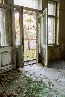 Open the door in an abandoned room