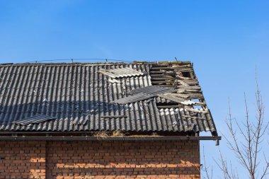 damaged tile on the roof