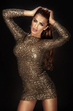 Wonderful girl wearing gorgeous shining dress