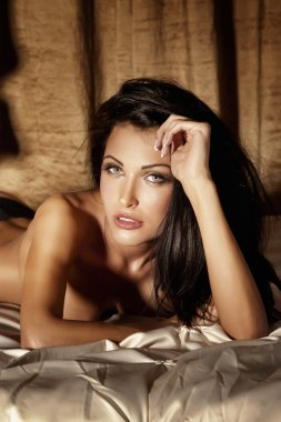 Portrait of beautiful and sexy woman looking at camera