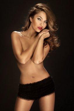 Fashion shot of beautiful sexy naked woman wearing only black pa