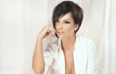 Portrait of beautiful brunette lady with short hair