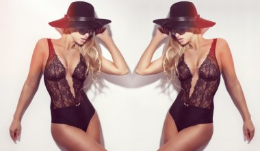 Sensual blond twins posing in black lingerie and hat.