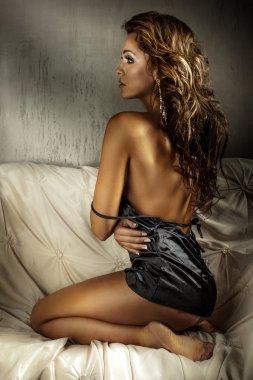 Sexy beautiful brunette lady posing in bedroom