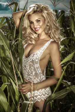 Sensual blonde woman smiling