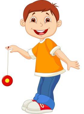 Young boy playing yo yo