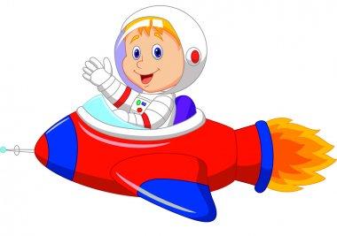 Cartoon boy astronaut in the spaceship