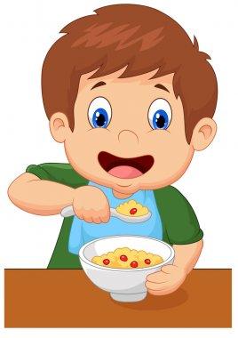 Boy is having cereal for breakfast