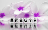 Beauty text with pink flowers