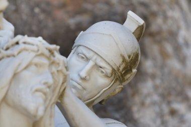 Placing crown of thorns Jesus by roman man