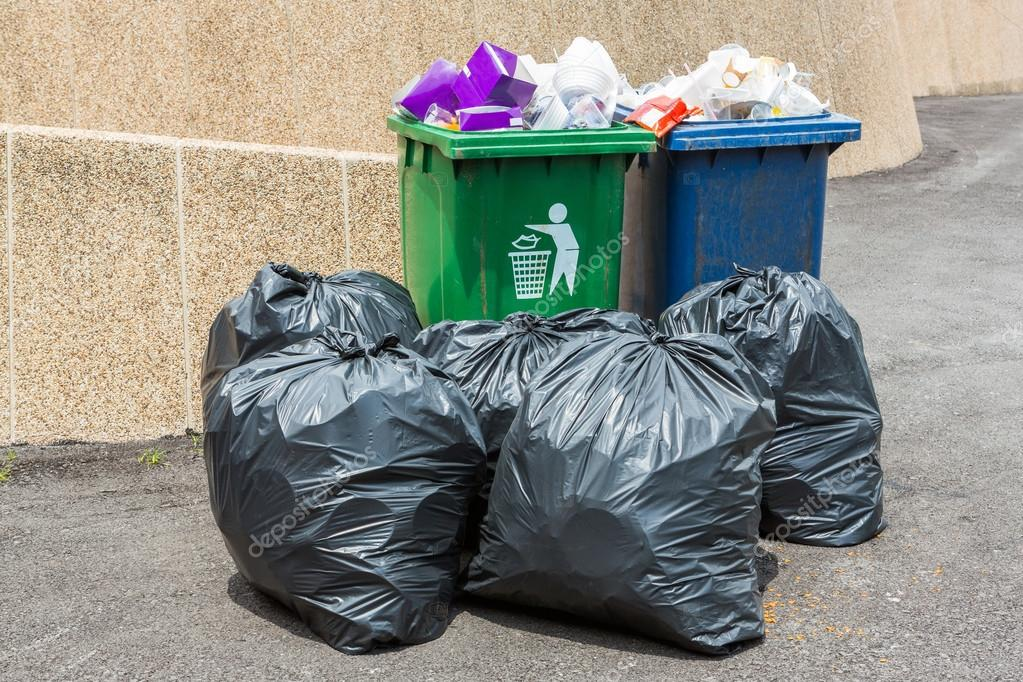 Trash bin and black garbage bag