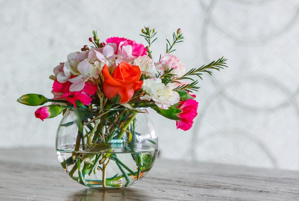 Flower bouquet in glass vase — Stock Photo © smuayc #42055529