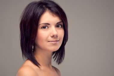 Portrait of a girl without a make-up with short hair (retro)