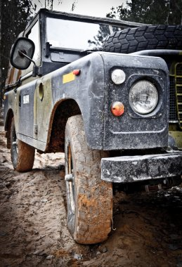 Old Land Rover Defender in the mud
