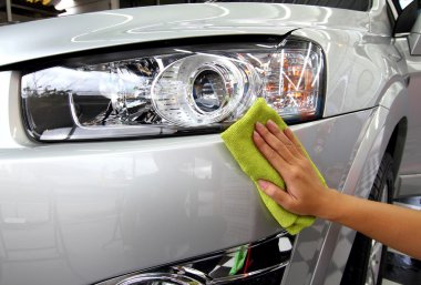 Hand with a wipe the car polishing car wash
