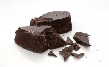 Cut and broken pieces of dark chocolate