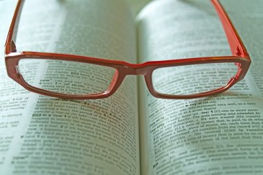 Dictionary and reading glasses