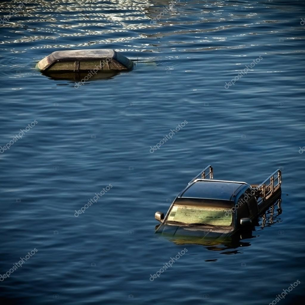 Cars submerge in the water