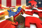 Photo Democrat Symbol Kicks Republican Symbol on a Chess Board