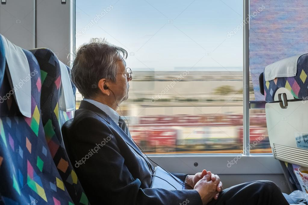 Japanese business man on a train