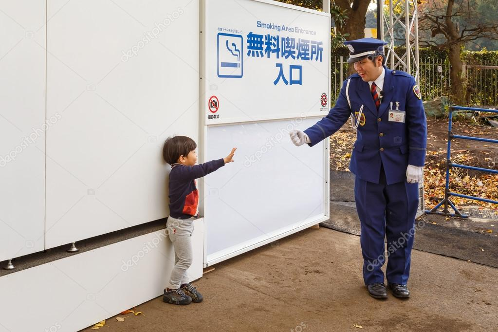 A boy with a Security Guard